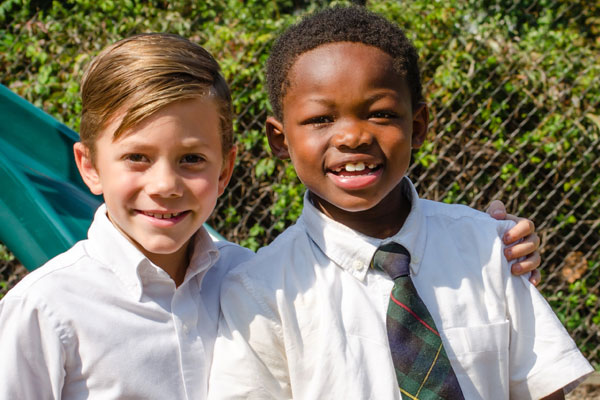 Oaks Academy lower school boys with arms around each other
