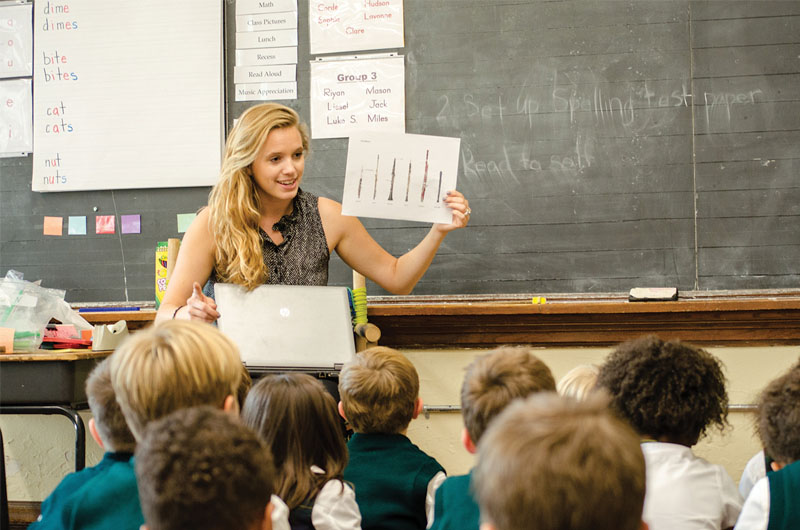 An Oaks Academy teacher in front of her class