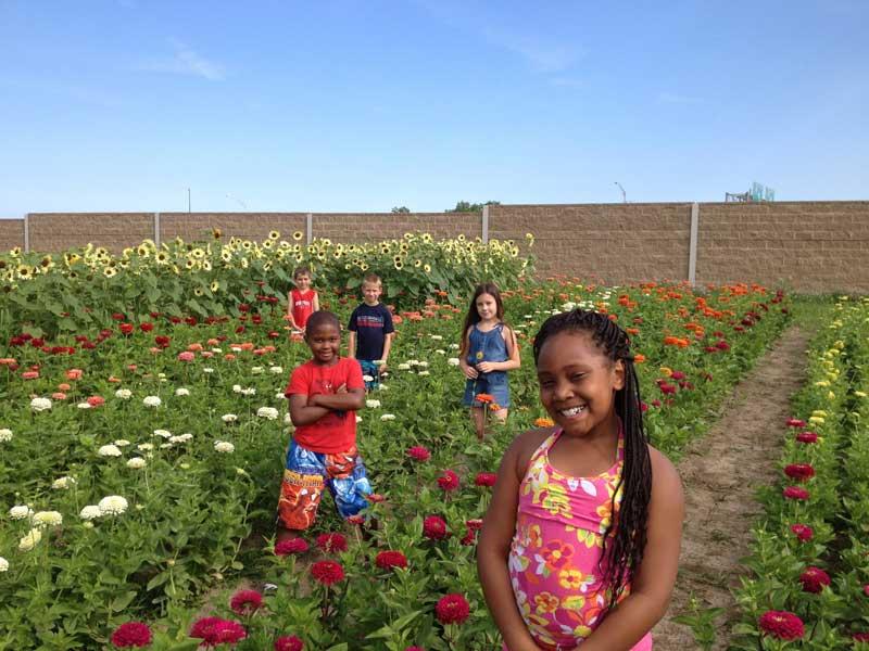 Oaks students in a field of flowers at Oaks Plus