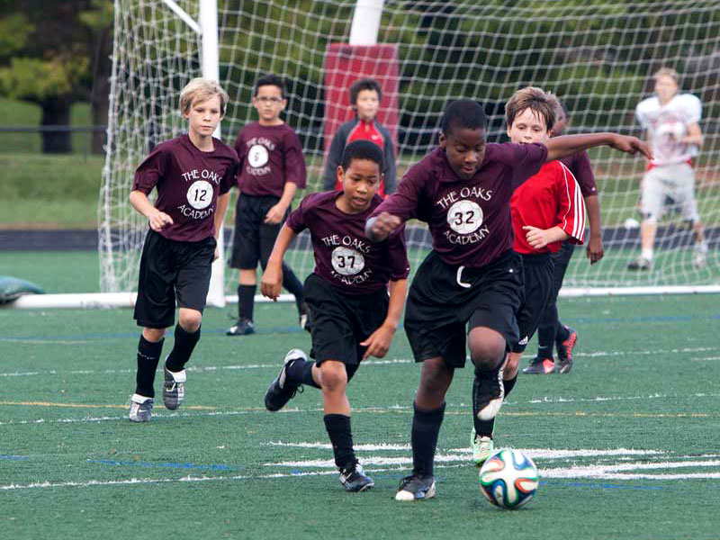 Oaks students playing soccer